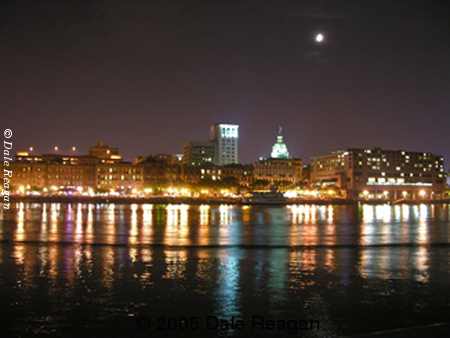 Photo:  Full moon over Savannah City Hall along the Savannah River (Savannah, Ga, USA.)